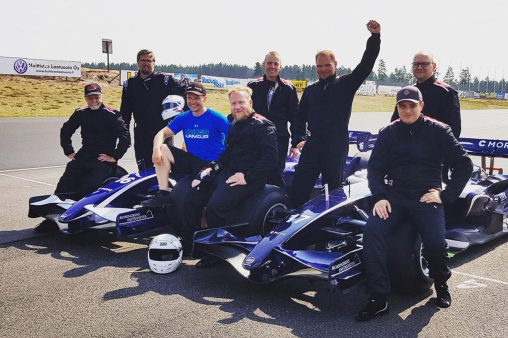 Happy customers after driving Formula-1 car at Alastaro Circuit